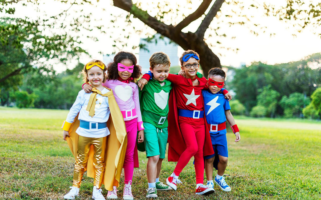 Superheroes kids playing outside